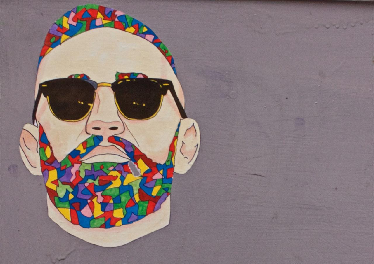 Popartbilde av mann med regnbueskjegg